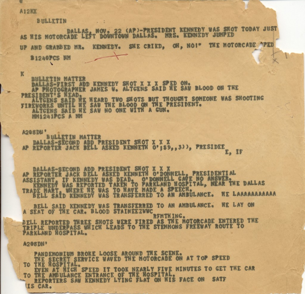 """This Nov. 22, 1963, file photo shows an Associated Press """"A"""" wire copy edited for the teletypesetter circuit, reporting on the assassination of Presid..."""