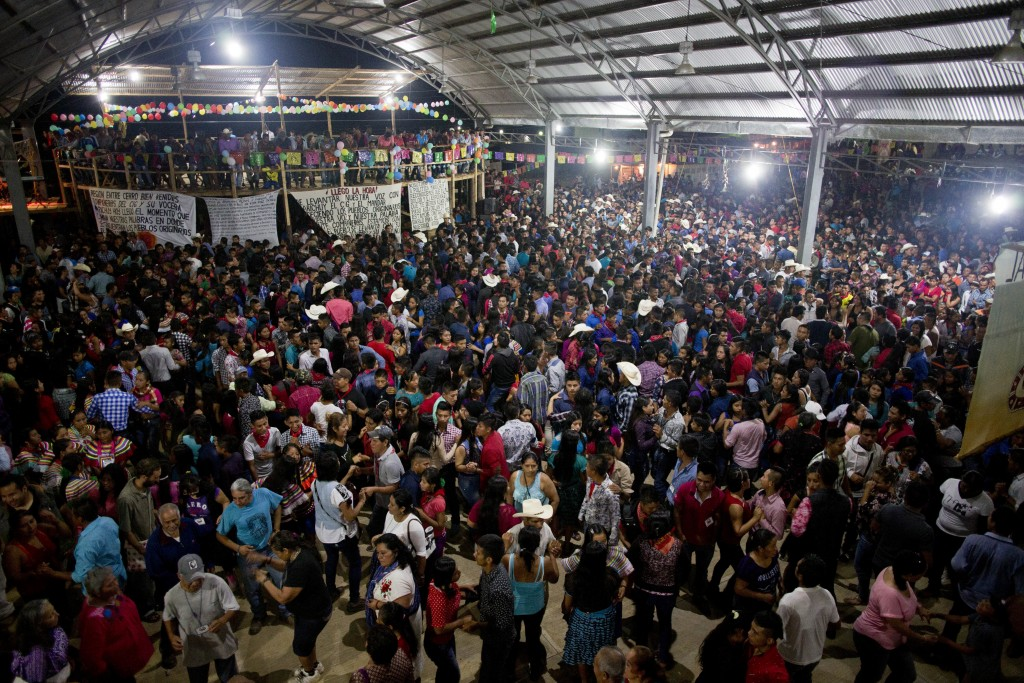 In this Saturday, Oct. 14, 2017 photo, people dance at the end of a campaign rally for Maria de Jesus Patricio, presidential candidate for the Nationa...