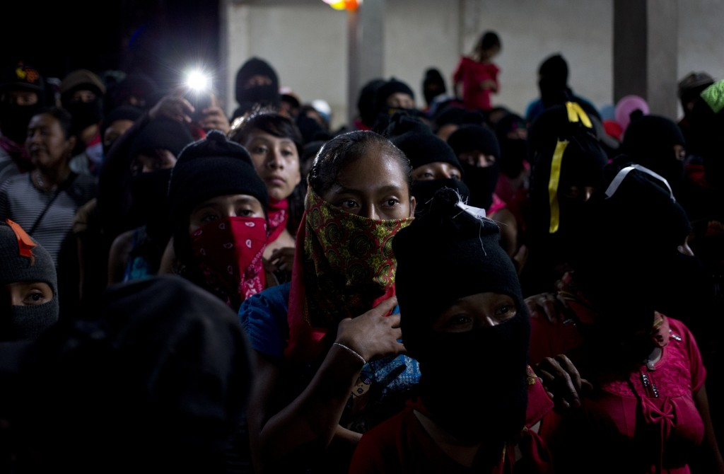 In this Tuesday, Oct. 17, 2017 photo, Zapatistas listen to Maria de Jesus Patricio, presidential candidate for the National Indigenous Congress, durin...