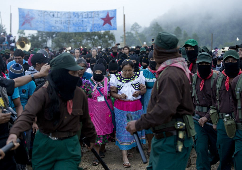In this Sunday, Oct. 15, 2017 photo, presidential candidate for the National Indigenous Congress, Maria de Jesus Patricio, is escorted by Zapatistas a...