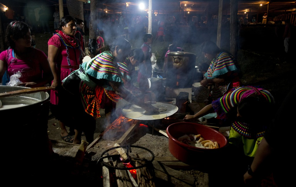 In this Saturday, Oct. 14, 2017 photo, women cook tortillas at the end of a campaign rally for Maria de Jesus Patricio, presidential candidate for the...