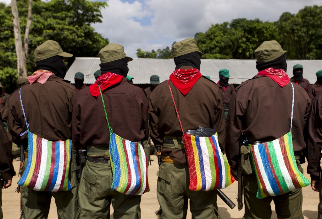In this Monday, Oct. 16, 2017 photo, members of the Zapatista National Liberation Army (EZLN) provide security along the campaign trail for presidenti...