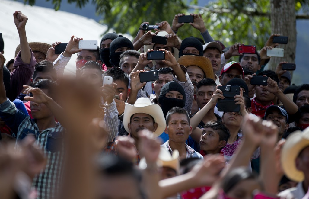 In this Saturday, Oct. 14, 2017 photo, supporters attend a campaign rally for Maria de Jesus Patricio, presidential candidate for the National Indigen...