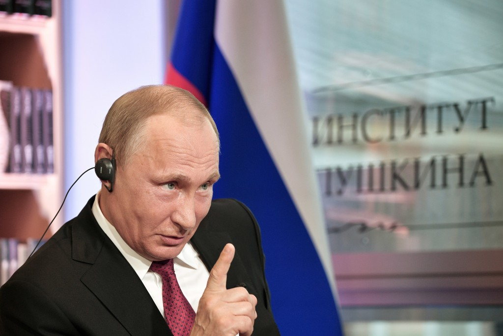 FILE - In this Monday, May 29, 2017 photo released by the Sputnik news agency, Russian President Vladimir Putin speaks during an interview in Paris, F...