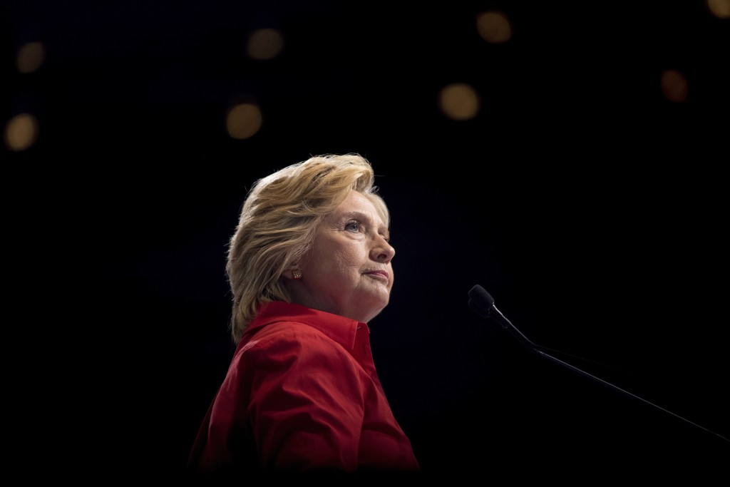 FILE - In this Saturday, July 30, 2016 file photo, Democratic presidential candidate Hillary Clinton pauses while speaking at a rally in Pittsburgh du...