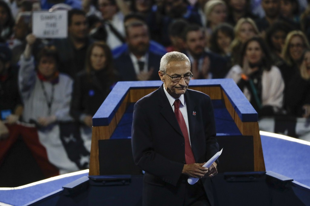 FILE - In this Wednesday, Nov. 9, 2016 file photo, John Podesta, Hillary Clinton campaign chairman, walks off the stage after announcing that Clinton ...
