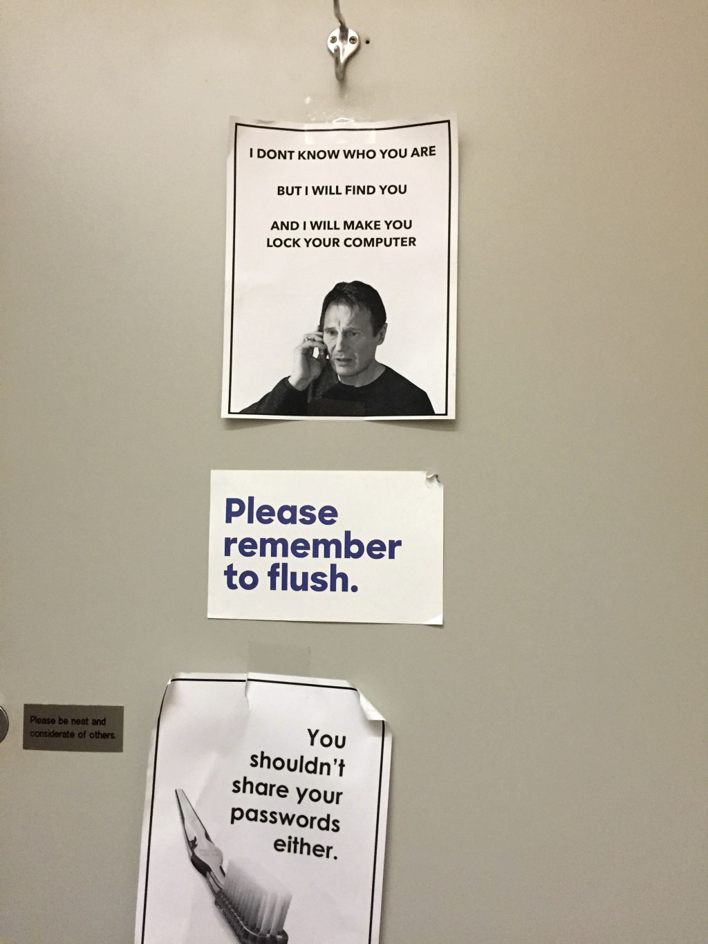This June 29, 2016 photo shows signs posted in a bathroom at Hillary Clinton's campaign headquarters in the Brooklyn borough of New York, reminding ca...