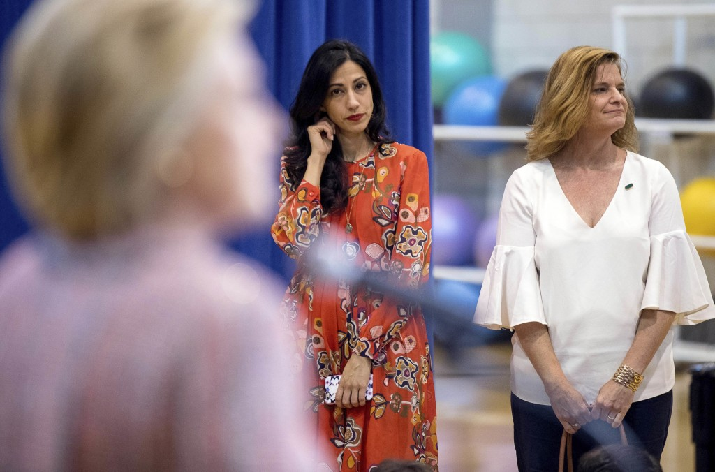 FILE - In this Thursday, Sept. 15, 2016 file photo, senior aide Huma Abedin, center, and Director of Communications Jennifer Palmieri, right, stand ne...