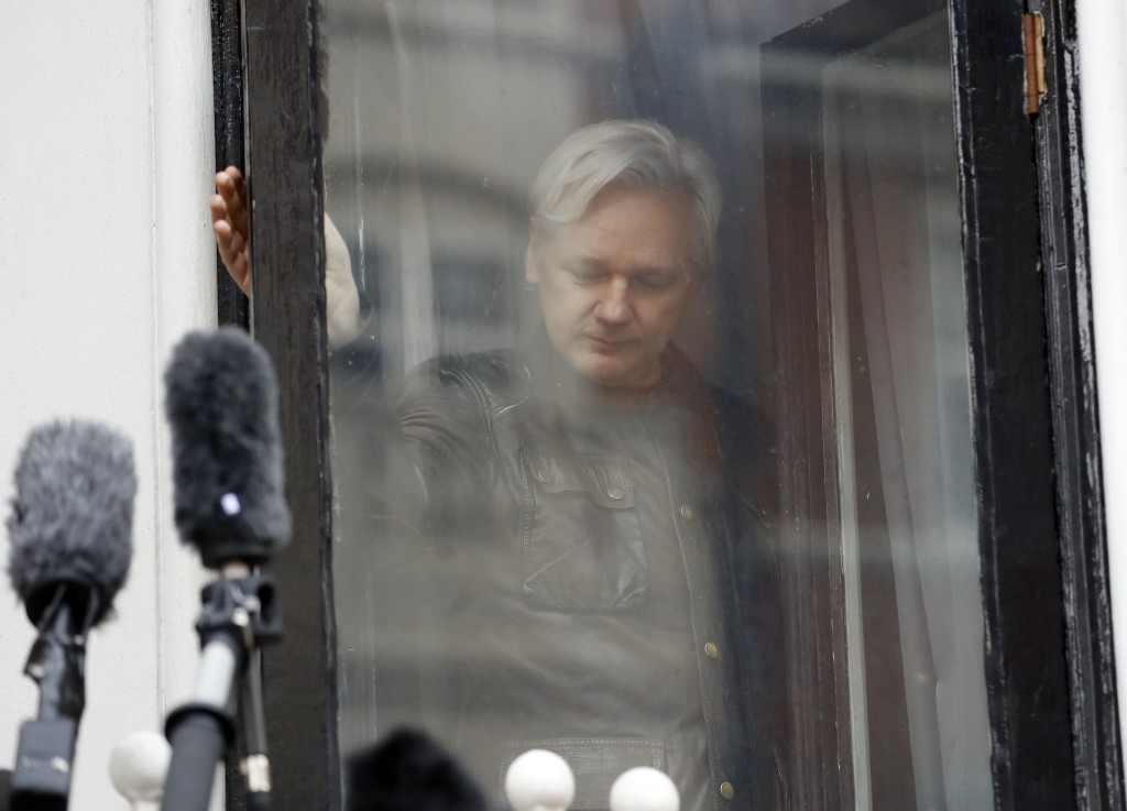 FILE - In this Friday May 19, 2017 file photo, WikiLeaks founder Julian Assange leaves after greeting supporters outside the Ecuadorian embassy in Lon...
