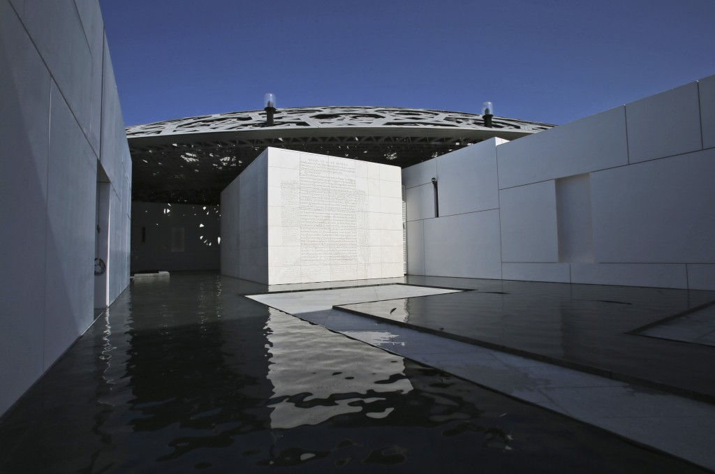 In this Monday, Nov. 6, 2017 photo, a limestone relief by American artist Jenny Holzer is seen at the Louvre Abu Dhabi, United Arab Emirates. The Louv...