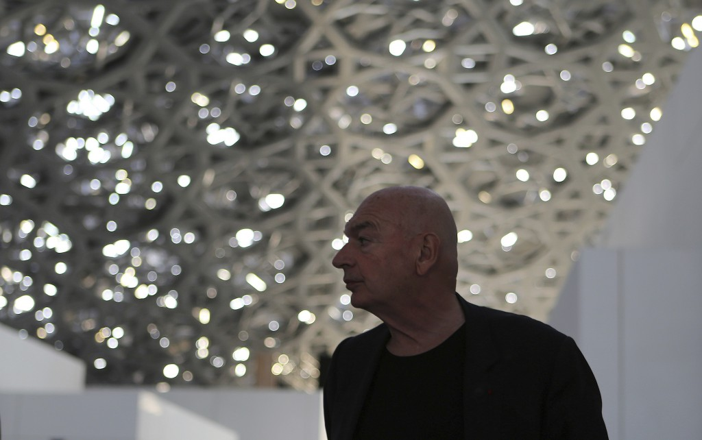 In this Monday, Nov. 6, 2017 photo, project designer French architect Jean Nouvel walks under the dome of the Louvre Abu Dhabi, United Arab Emirates.