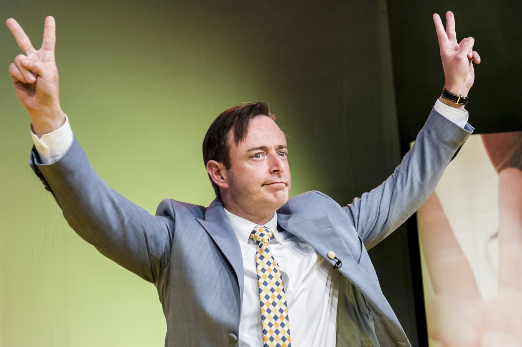 FILE - In this May 25, 2014 file photo, the leader of the NVA (New Flemish Alliance) Bart De Wever makes a victory sign as he arrives to address his p...