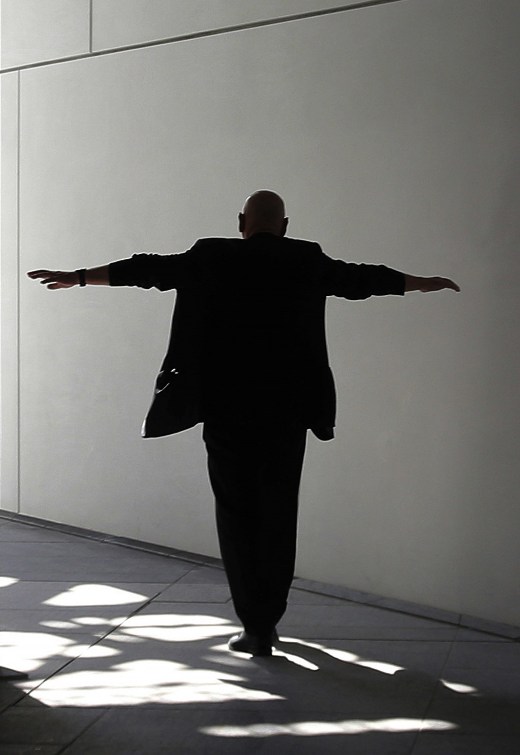 In this Monday, Nov. 6, 2017, photo, project designer French architect Jean Nouvel walks under the dome of the Louvre Abu Dhabi, United Arab Emirates....