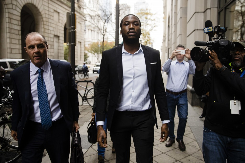 Rapper Meek Mill, center, accompanied by his defense attorney Brian Mcmonagle arrives at the criminal justice center in Philadelphia, Monday, Nov. 6,