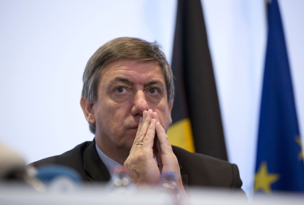 FILE - In this Saturday, Nov. 21, 2015 file photo, Belgium's Interior Minister Jan Jambon pauses before speaking during a media conference at the Prim...