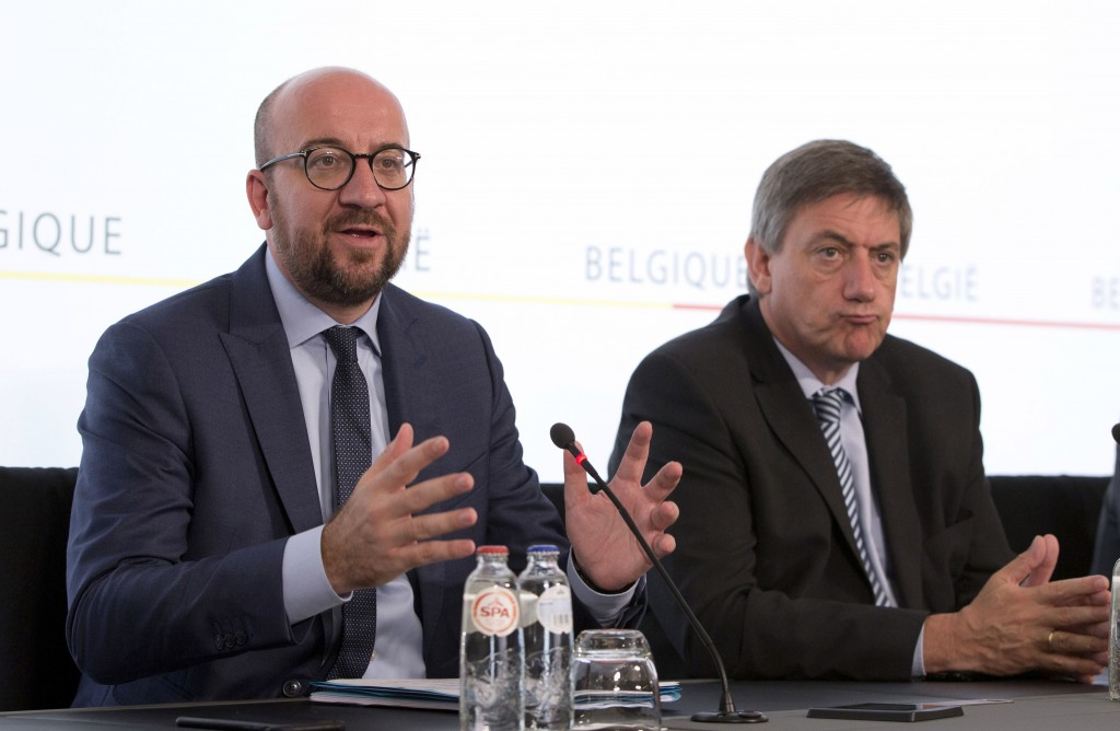 FILE -  In this June 21, 2017 file photo, Belgian Prime Minister Charles Michel, left, and Belgium's Minister for the Interior Jan Jambon address the ...