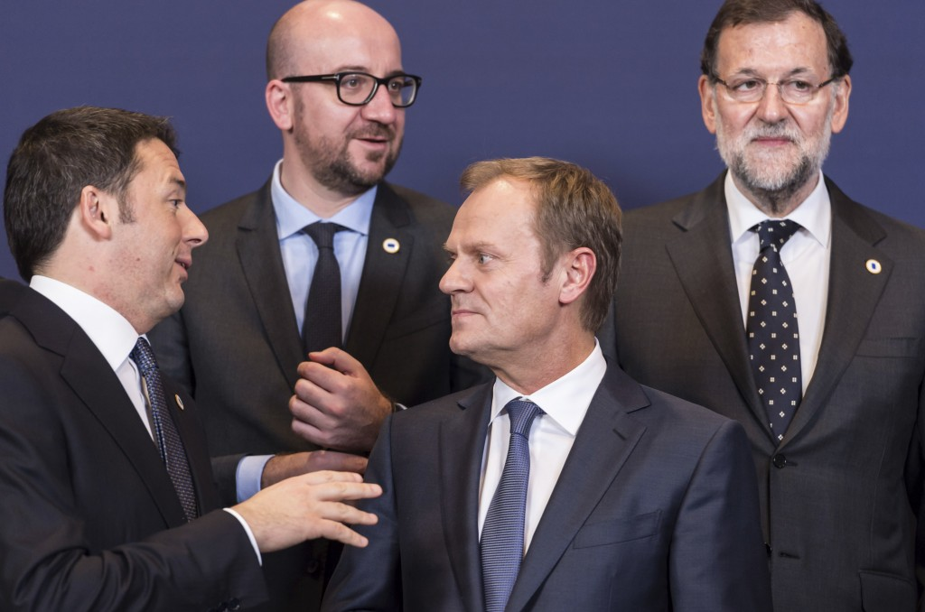 FILE - In this Dec. 18, 2014 file photo, EU leaders pose for a group photo at an EU summit in Brussels. The outlawed Catalan independence referendum h...
