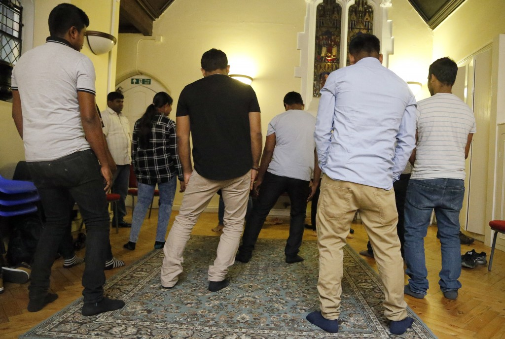 In this July 27, 2017, photo, Sri Lankans, many of whom said they were tortured in their home country, gather at a church in London. Sri Lankan tortur...