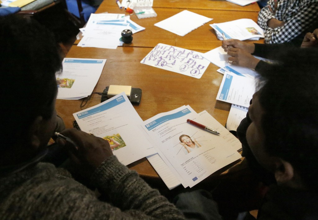 In this July 27, 2017, photo, Sri Lankans, many of whom said they were tortured in their home country, attend an English class in London. Sri Lankan t...