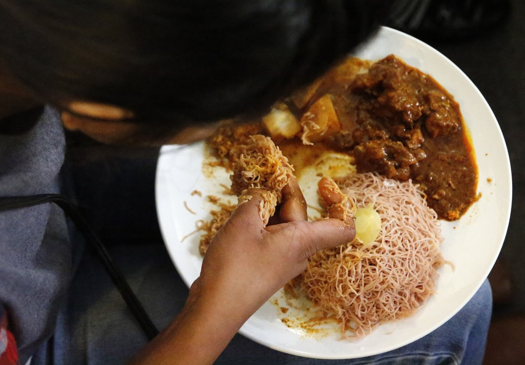 In this July 27, 2017, photo, a Sri Lankan torture survivor eats lunch in London. Sri Lankan torture survivors seeking asylum in Europe travel to Lond...