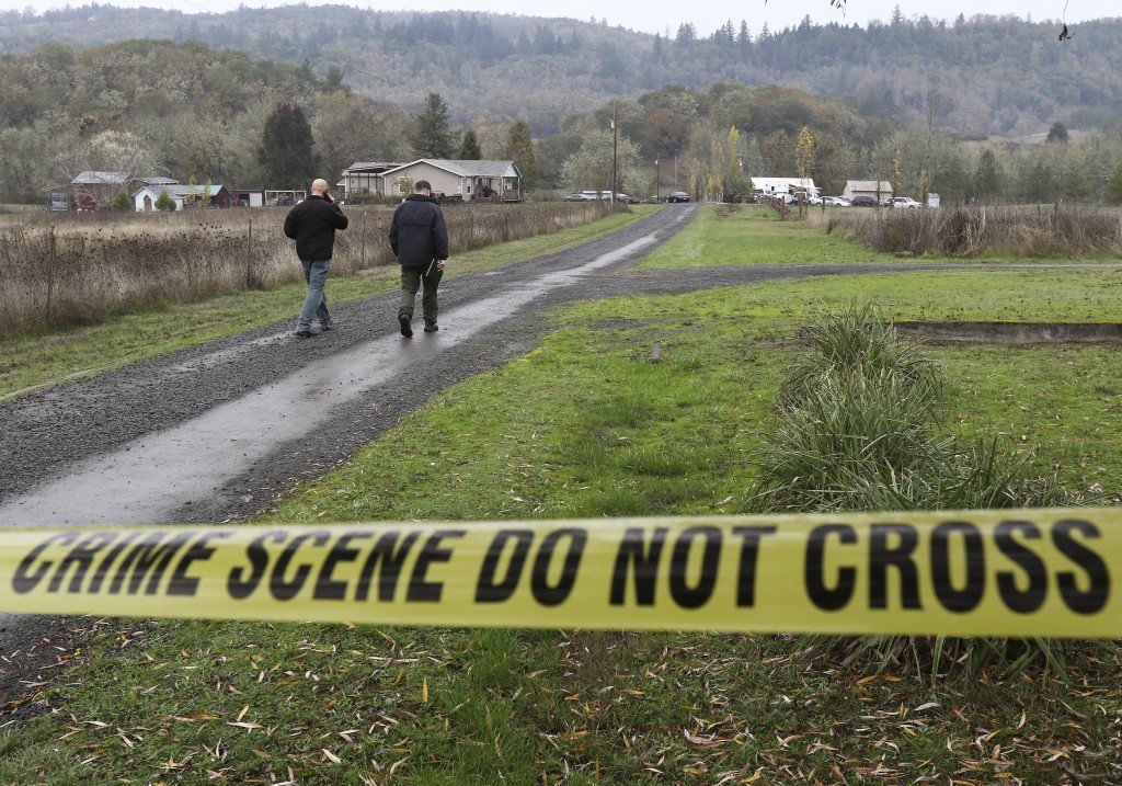 Investigators work at the scene of an alleged homicide, Wednesday Nov. 8, 2017 in Lookingglass, Ore. Authorities arrested a 16-year-old boy accused of...