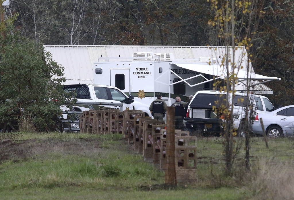Investigators work at the scene of a triple homicide, Wednesday Nov. 8, 2017 in Lookingglass, Ore. Authorities arrested a 16-year-old boy accused of f...