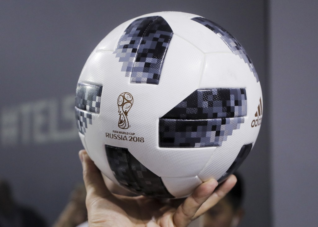 f98e43287 Argentinian national soccer team striker Lionel Messi shows the official  match ball for the 2018 FIFA