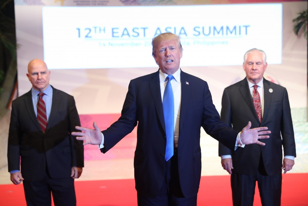 Flanked by U.S. National Security Advisor H.R. McMaster, left, and U.S. Secretary of State Rex Tillerson, right, U.S. President Donald Trump offers a