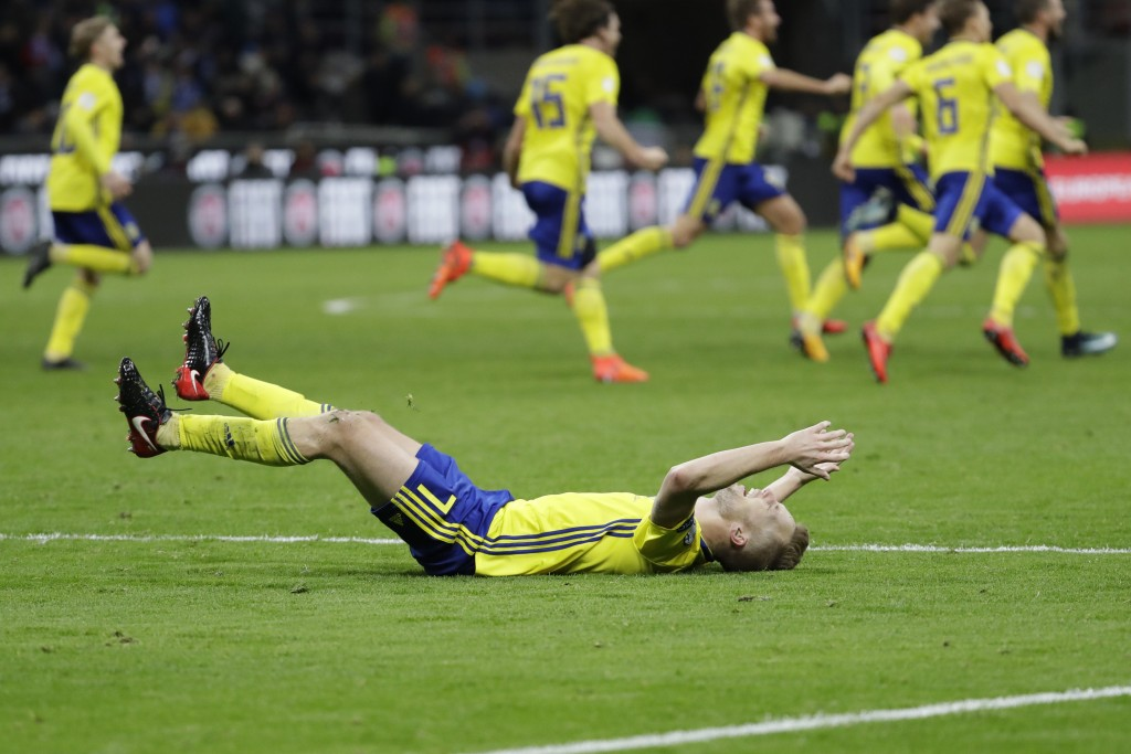 Swedish players react to their qualification at the end of the World Cup qualifying play-off second leg soccer match between Italy and Sweden, at the