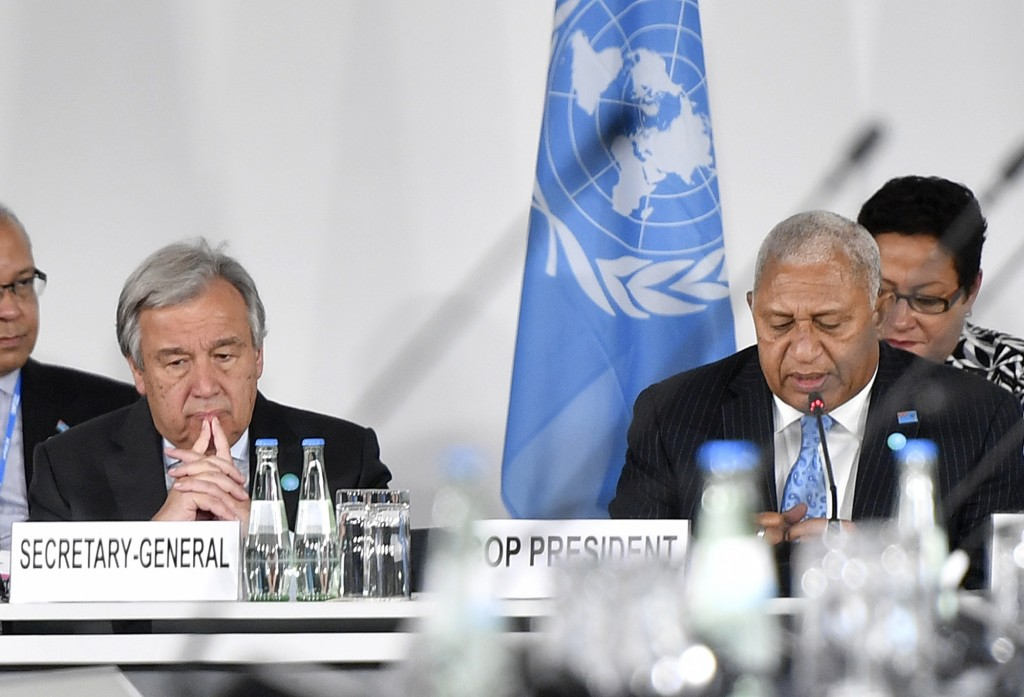 UN Secretary General Antonio Guterres, left, and Fiji prime minister and COP president Frank Bainimarama attend a round table meeting during the 23rd