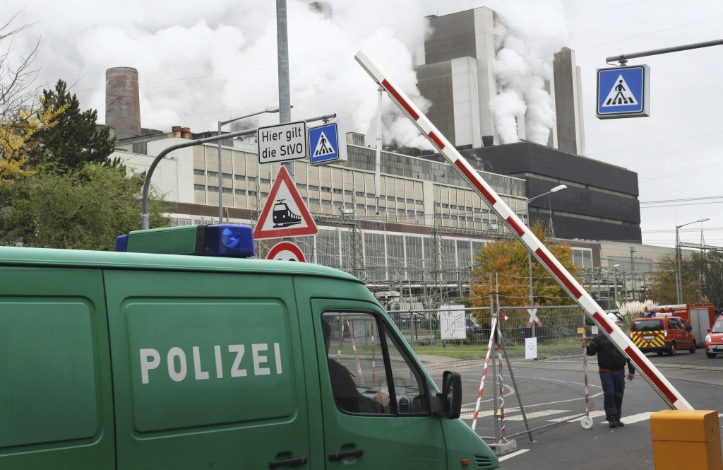 Police vehicles driving into the premises of the Weisweiler coal-fired power plant near Aachen, Germany, Wednesday  Nov. 15, 2017. According to German