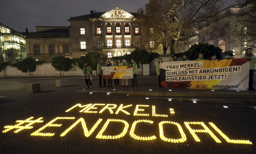 1,200 candles are  placed by environmental activists, in  front of a building close to the German federal parliament, a where German Chancellor Angela