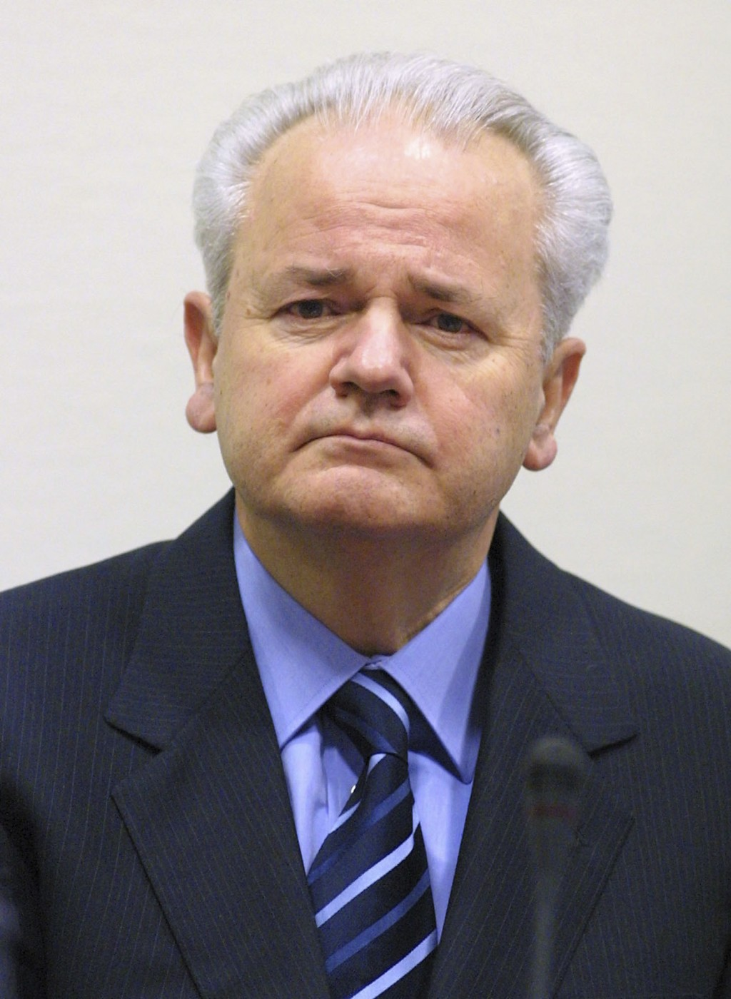 FILE - In this Jan. 9, 2002 file photo, former Yugoslav President Slobodan Milosevic sits down in a courtroom of the war crimes tribunal in The Hague,...