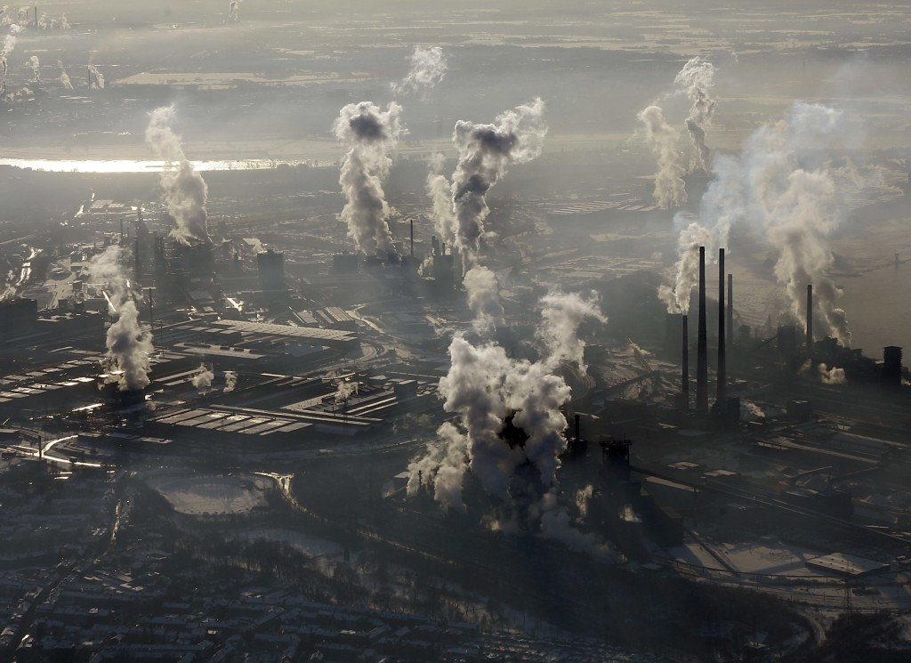 FILE - In this Jan. 9, 2009 file photo smoke rises from the steel company ThyssenKrupp in Duisburg , western Germany. Levels of carbon dioxide in the
