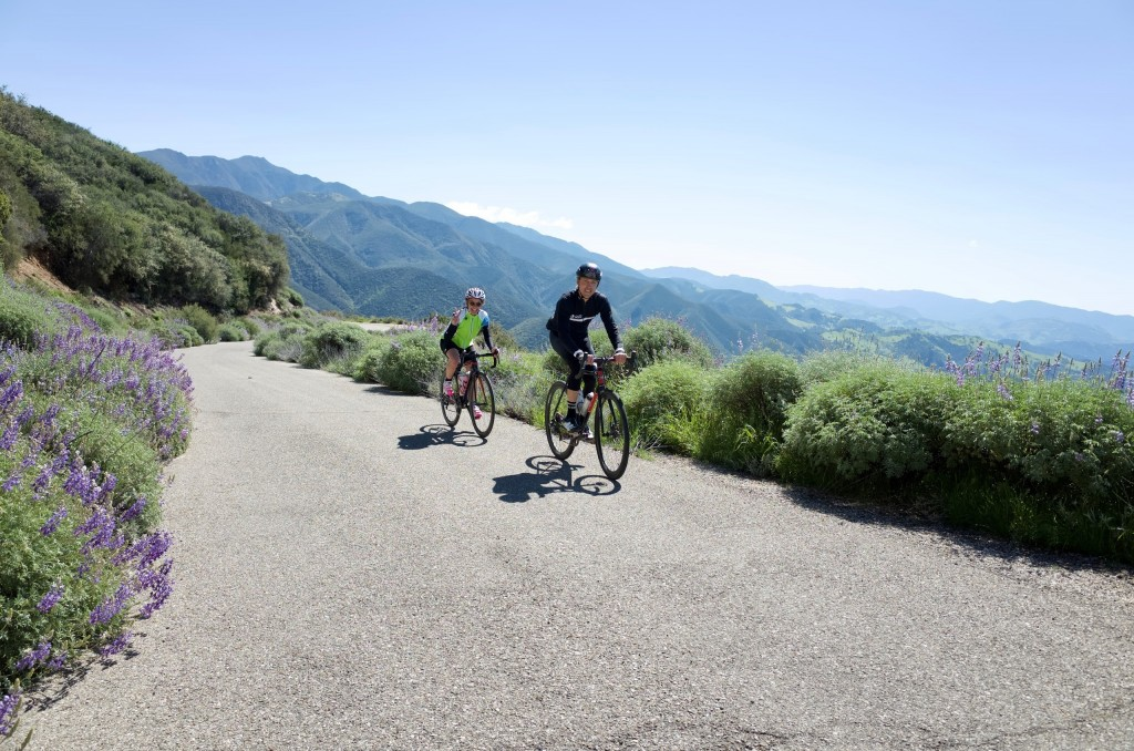 In this undated photo provided by The Cycling House, two cyclists are shown on Mount Figueroa outside of Solvang, Calif., during a tour run by the Mon...