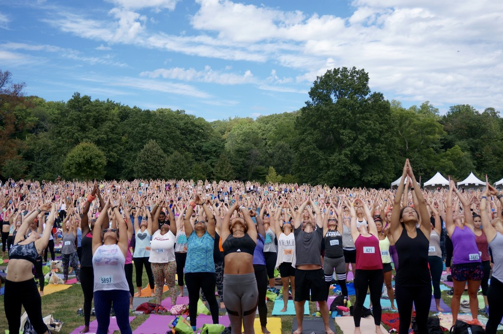 """This 2017 photo provided by Wanderlust Festival shows people taking part in an outdoor yoga class at """"Wanderlust 108"""" in the Brooklyn borough of New Y..."""