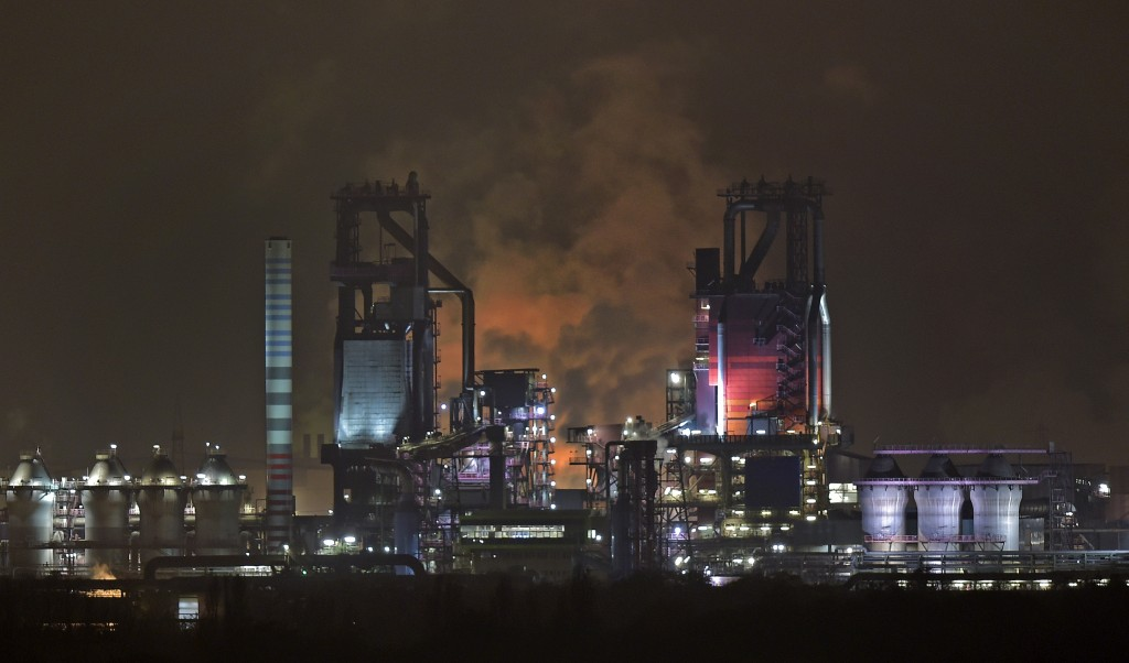 FILE - The Nov. 19, 2014 file photo shows two furnaces at the ThyssenKrupp steel plant in Duisburg. A new facility scheduled to open in April 2018 wil