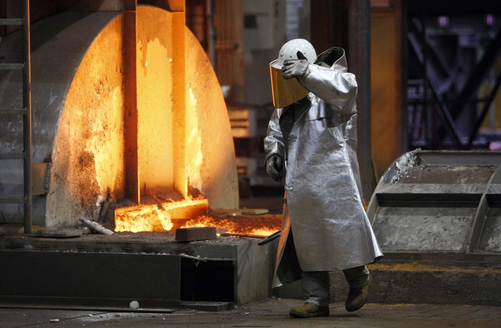 FILE - The Jan. 28, 2008 file picture shows a worker walking in the new furnace at the ThyssenKrupp steel factory in Duisburg, Germany. A new facility