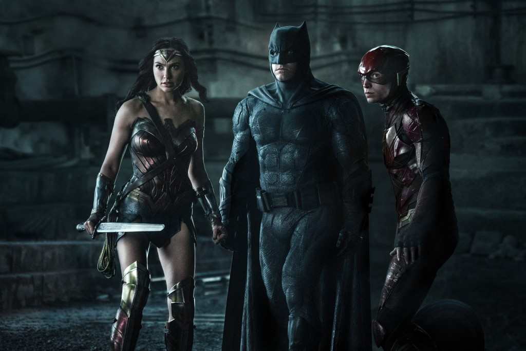 """This image released by Warner Bros. Pictures shows Gal Gadot, from left, Ben Affleck and Ezra Miller in a scene from """"Justice League."""" (Clay Enos/Warn..."""