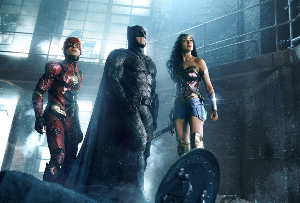 """This image released by Warner Bros. Pictures shows Ezra Miller, from left, Ben Affleck and Gal Gadot in a scene from """"Justice League."""" (Warner Bros. E..."""