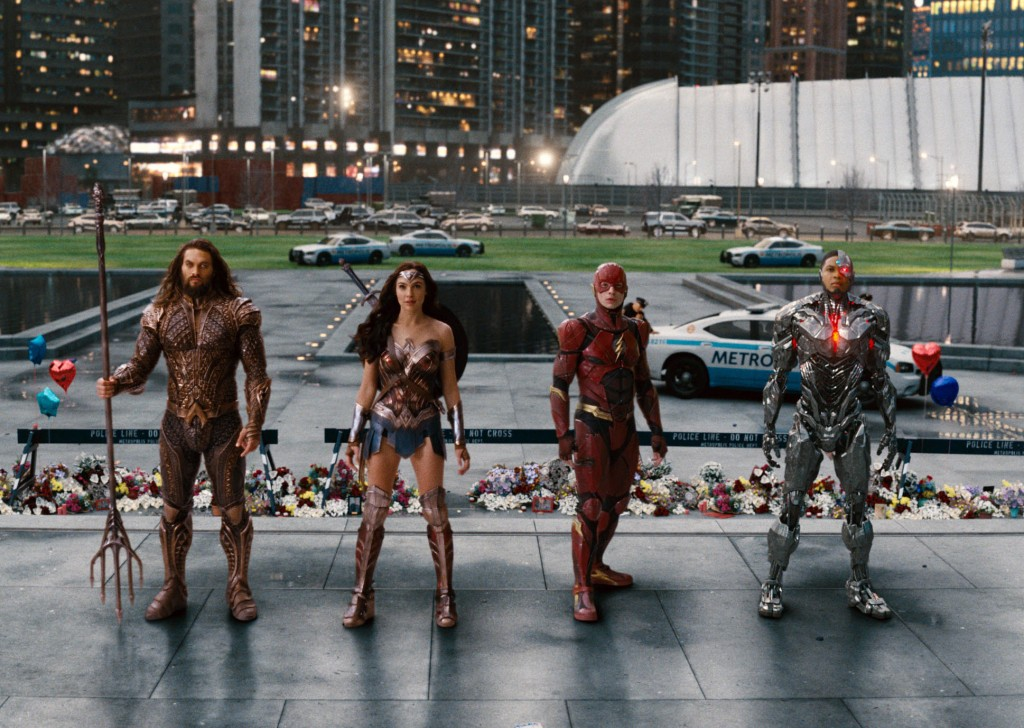 """This image released by Warner Bros. Pictures shows Jason Momoa, from left, Gal Gadot, Ezra Miller and Ray Fisher in a scene from """"Justice League."""" (Wa..."""