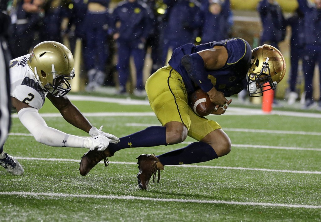 Notre Dame wide receiver Kevin Stepherson (29) makes a catch in the end zone for a touchdown in front of Navy safety Jarid Ryan (2) during the second ...
