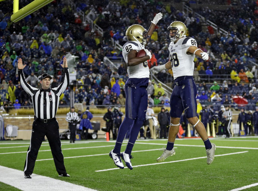 Navy wide receiver Craig Scott (82) celebrates a touchdown catch with Tyler Carmona (88) against Notre Dame during the second half of an NCAA college