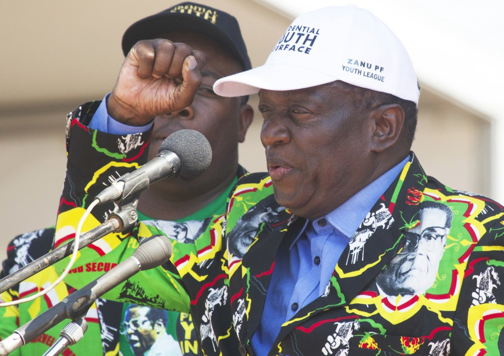 FILE - In this Aug. 30 2017 file photo, Zimbabwean Deputy President, Emmerson Mnangagwa, greets party supporters at a ZANU-PF rally in Gweru, Zimbabwe...