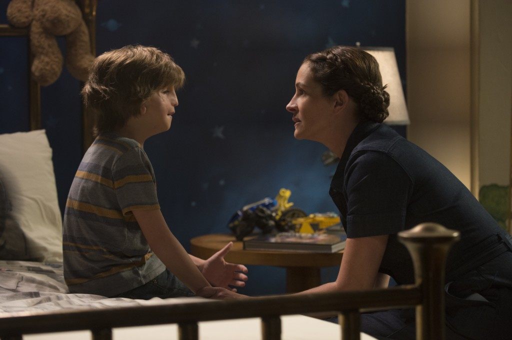 """This image released by Lionsgate shows Jacob Tremblay, left, and Julia Roberts in a scene from """"Wonder."""" (Dale Robinette/Lionsgate via AP)"""
