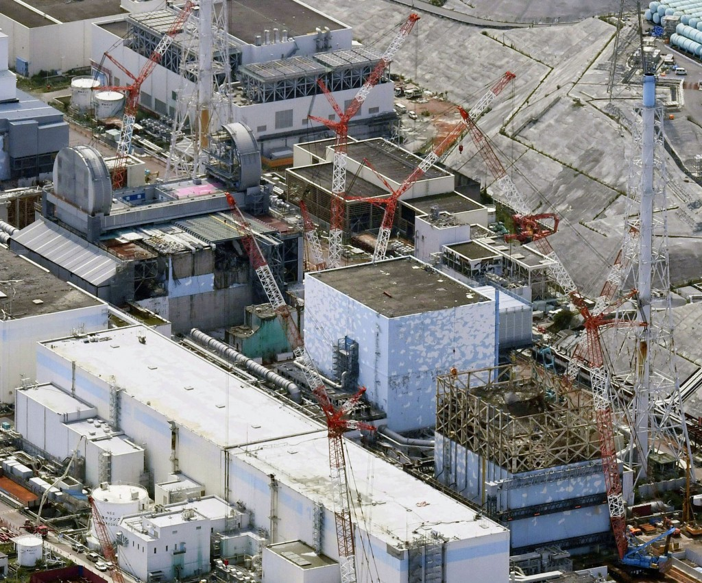 This Sept. 4, 2017 aerial photo shows Fukushima Dai-ichi nuclear power plant reactors, from bottom at right, Unit 1, Unit 2 and Unit 3, in Okuma, Fuku