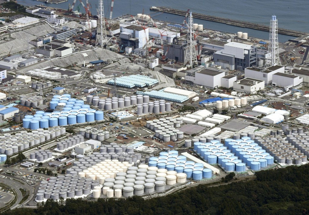 In this Sept. 2017, photo, tanks are seen at Fukushima Dai-ichi nuclear plant in Okuma.  More than six years after a tsunami overwhelmed the Fukushima