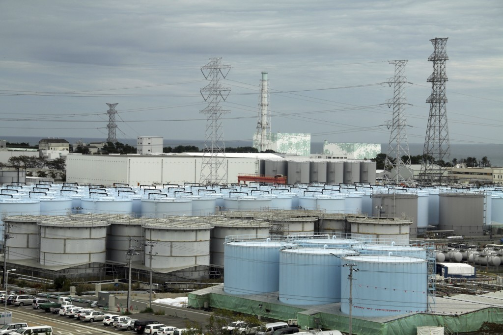 In this Oct. 12, 2017, photo, ever-growing amount of contaminated, treated but still slightly radioactive, water at the wrecked Fukushima Dai-ichi nuc