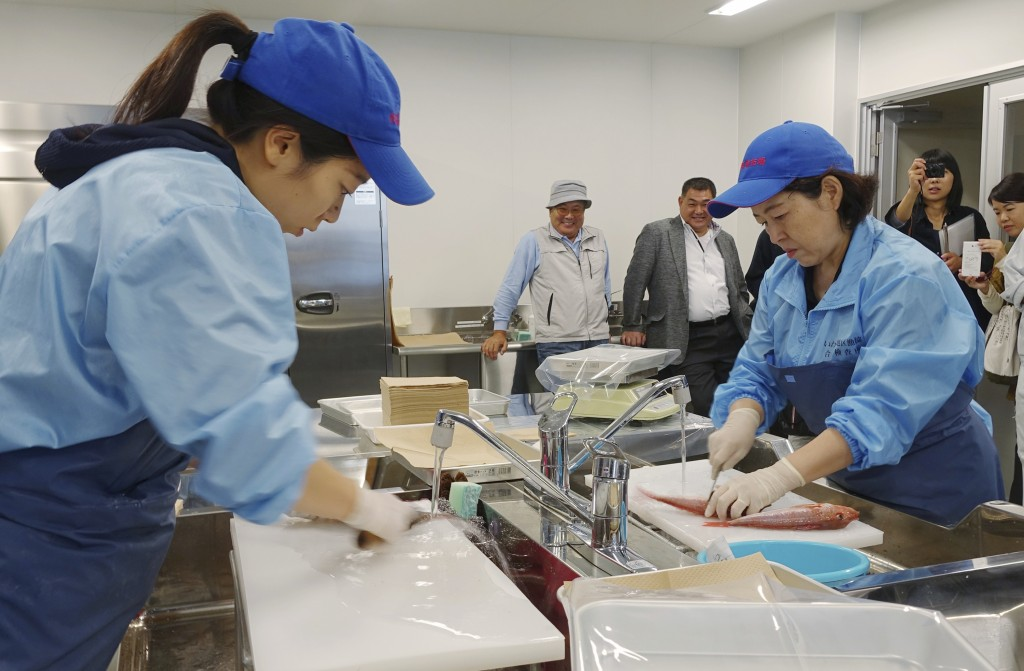 In this Oct. 12, 2017, photo, lab technicians at the Fukushima Prefectural Fisheries Experimental Station at Onahama Port in Iwaki city prepare fish t