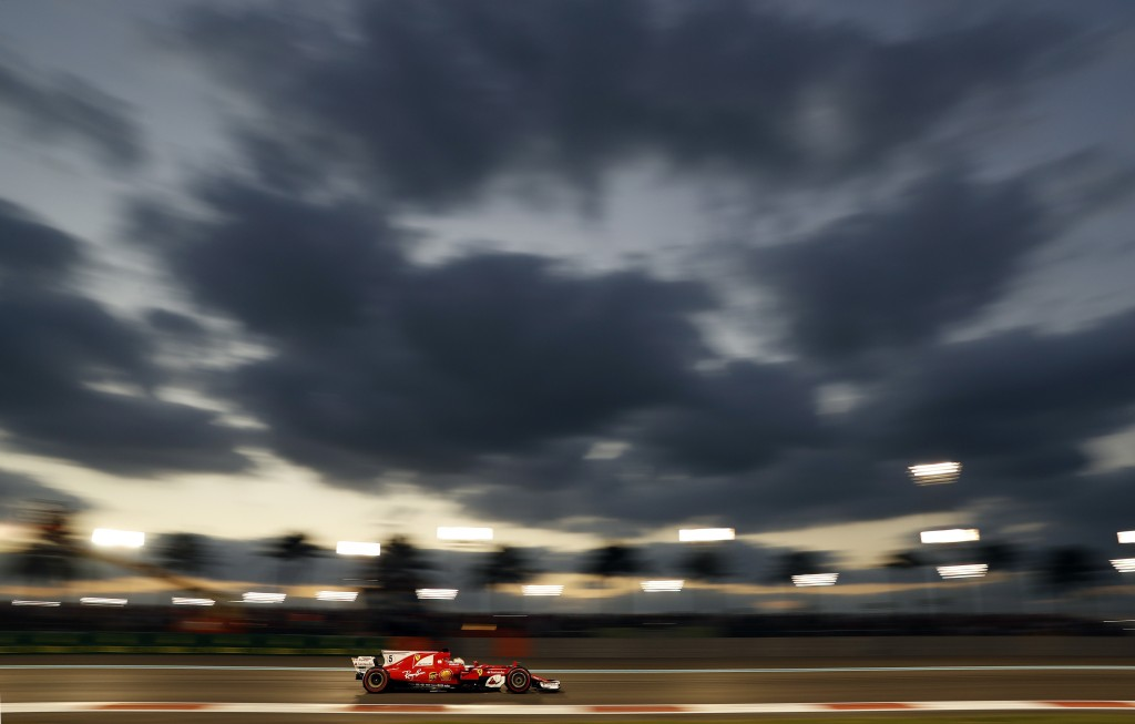 Ferrari driver Sebastian Vettel of Germany steers his car during the Emirates Formula One Grand Prix at the Yas Marina racetrack in Abu Dhabi, United